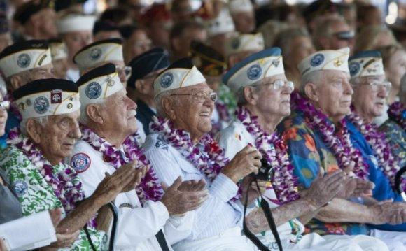 Pearl Harbor survivors watch a
