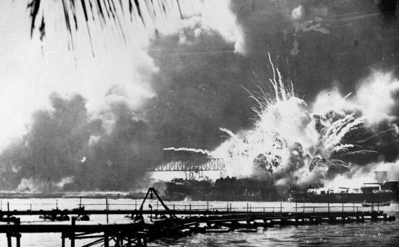 The USS Shaw explodes after