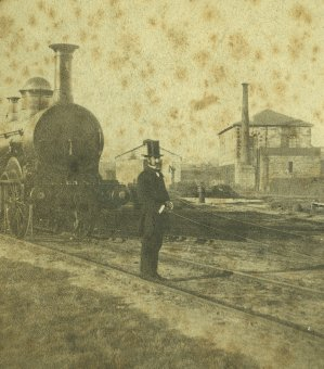 Locomotive No. 1 shown in Sydney yard with a frock-coated railway official, possibly a station master. Detail a stereoview published by William Hetzer, Sydney, 1858-1860. Powerhouse Museum collection P.3145-7. Gift of Royal Australian Historical Society, 1981.